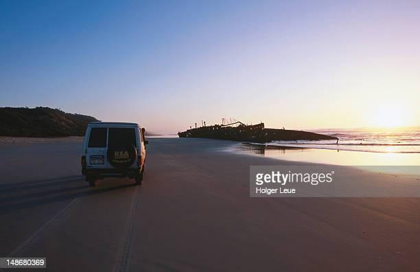 4WD and Maheno shipwreck at dawn.
