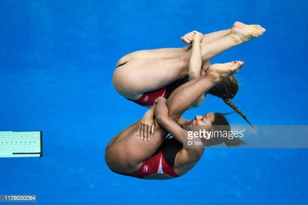 Melissa Citrini Beaulieu and Jennifer Abel of Canada compete in 3m Springboard Synchro Women Final of Diving World Series at Water Cube on March 7...