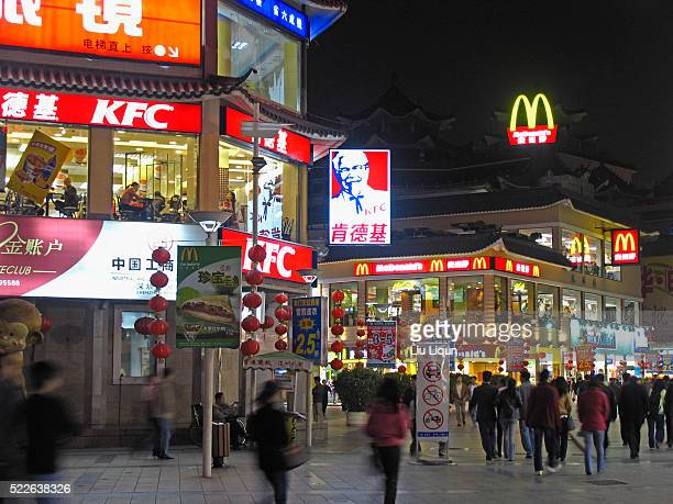 kfc and mcdonald's in old town area of shenzhen - mcdonald's stock pictures, royalty-free photos & images