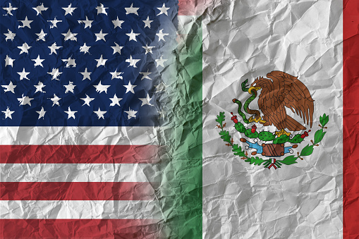 US and Mexico on crumpled paper, policy and relations concept 1024325372