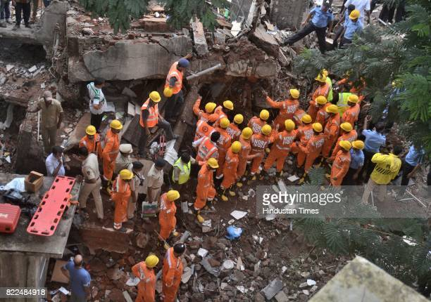 NDRF and Mumbai Fire Brigade trying to search and rescue people who caught in a building named Sai Darshan Apartment which collapsed at Ghatkopar...
