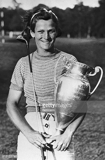 And now Mildred Babe Didrikson has entered new fields of sport and conquered them in short order Here she is proudly clutching the trophy she won in...