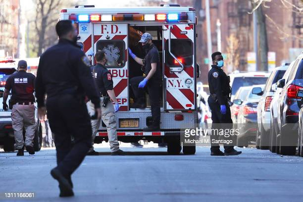 And NYPD officers respond to the scene of a shooting that left multiple people injured in the Flatbush neighborhood of the Brooklyn borough on April...