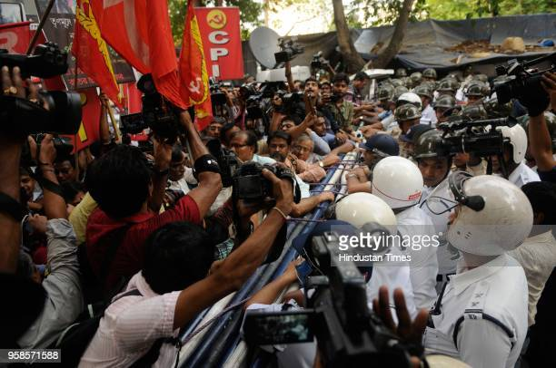 CPI and other Left Front supporters demonstrate a protest rally against death of CPI supporter couple Debu and Usha Das allegedly by Trinamool goons...