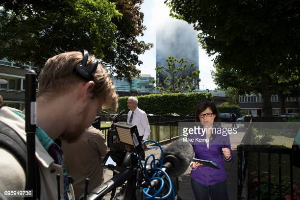 TV and other media reporting from near to a blaze at Grenfell Tower near Notting Hill on 14th June 2017 in West London United Kingdom The huge fire...