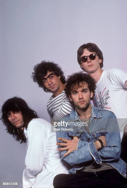 Photo of REM and Peter BUCK and Bill BERRY and Michael STIPE and Mike MILLS Posed studio group portrait LR Peter Buck Bill Berry Michael Stipe and...