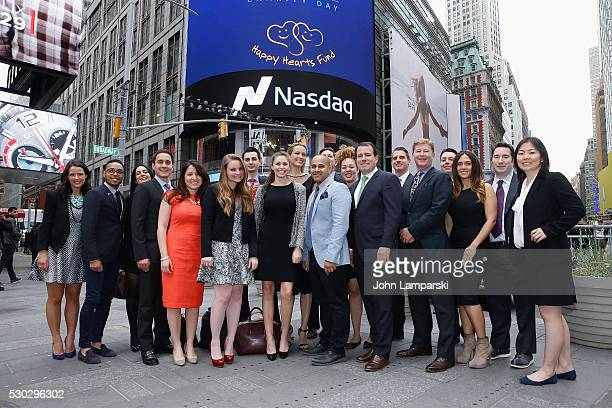 BTIG and Petra Nemcova ring Nasdaq Closing Bell for Charity Day at NASDAQ on May 10 2016 in New York City
