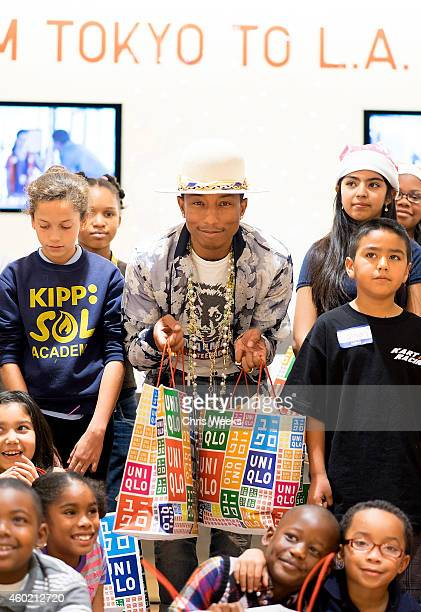 UNIQLO and Pharrell Williams Host Charity Shopping Event for Children in Need at UNIQLO Beverly Center Store on December 9 2014 in Los Angeles...