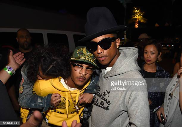 I and Pharrell Williams seen during day 1 of the 2014 Coachella Valley Music Arts Festival at the Empire Polo Club on April 11 2014 in Indio...