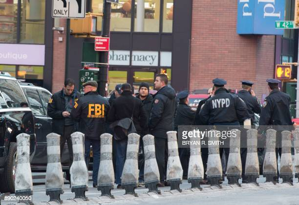 FBI and police respond to a reported explosion at the Port Authority Bus Terminal on December 11 2017 in New York New York police said Monday that...