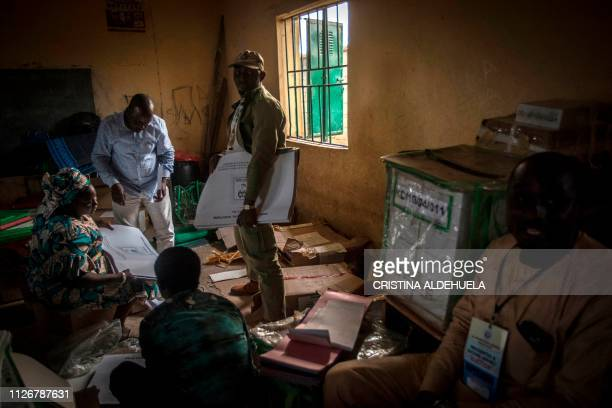 INEC and polling station workers prepare ballot and ballot boxes to be sent to the respective polling stations for the elections at The Badikko...