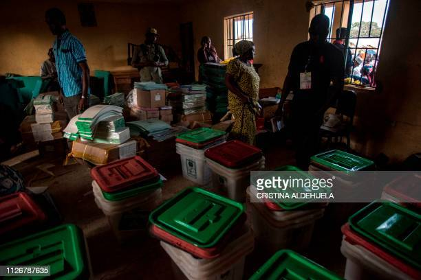 TOPSHOT INEC and polling station workers prepare ballot and ballot boxes to be sent to the respective polling stations for the elections at The...
