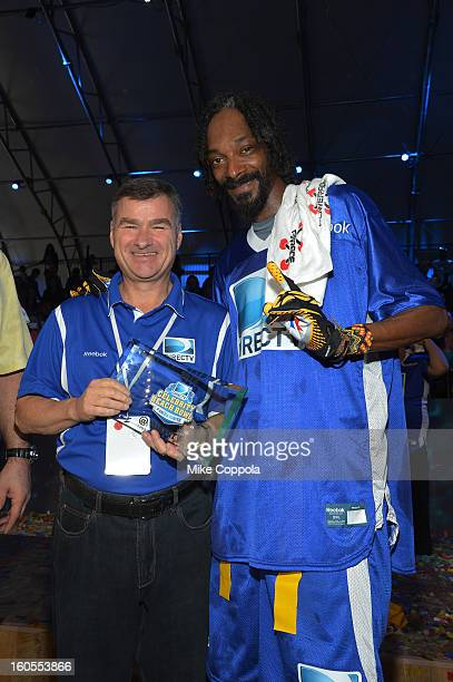 CEO and President of DIRECTV Michael White and rapper Snoop Dogg attend DIRECTV'S Seventh Annual Celebrity Beach Bowl at DTV SuperFan Stadium at...
