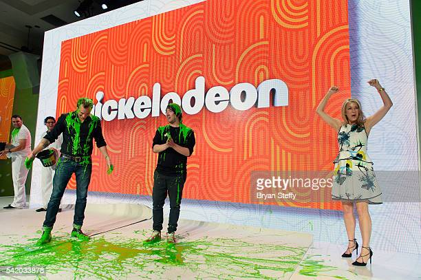 CMO and President of Nickelodeon Consumer Products Pam Kaufman reacts as musicians Tim G Lopez and Tom Higgenson of Plain White T's get slimed during...