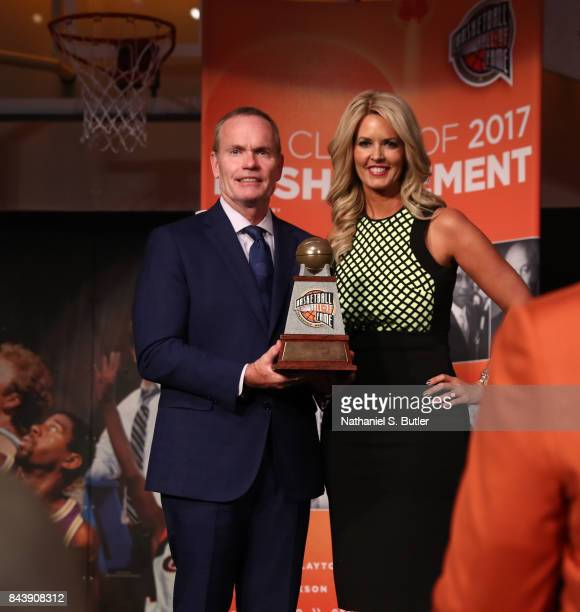 CEO and President of the Basketball Hall of Fame John Doleva poses with Stacy Sager on behalf of Craig Sager after winning the Electronic Media Award...
