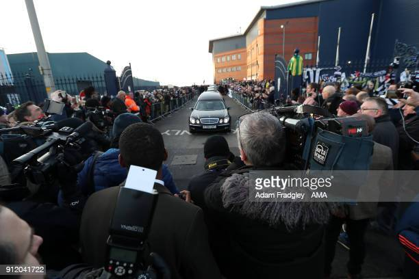TV and print Media gather around the hearse as it departs the stadium Funeral Service of former West Bromwich Albion player Cyrille Regis at he...