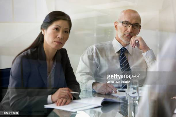 CEO and project manager interviewing employees for project team