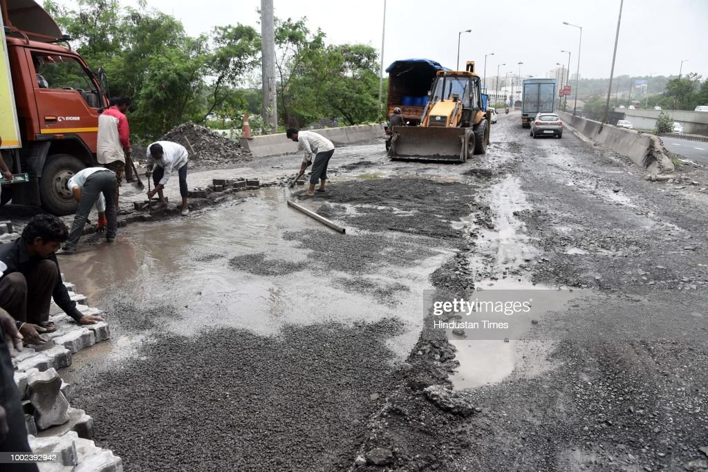 NMMC And PWD Workers Repair Sion Panvel Highway