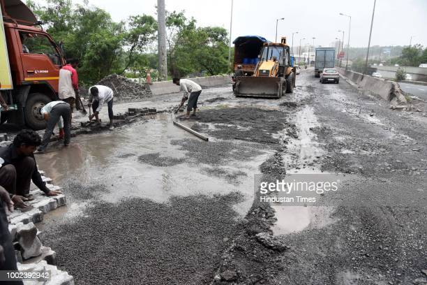 NMMC and PWD workers repairing the Sion Panvel highway on July 19 2018 in Navi Mumbai India Public Works Department Chief Engineer Sunil Wandhekar...