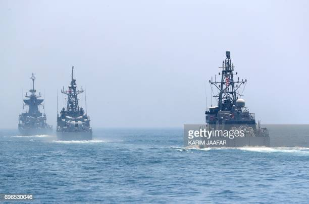 US and Qatari navy vessels are seen during a joint military exercise between Qatar and the US navy in Doha on June 16 2017 The United States agreed a...