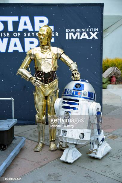 """And R2-D2 pose at the IMAX opening of """"Star Wars: The Rise Of Skywalker"""" at TCL Chinese Theatre on December 19, 2019 in Hollywood, California."""