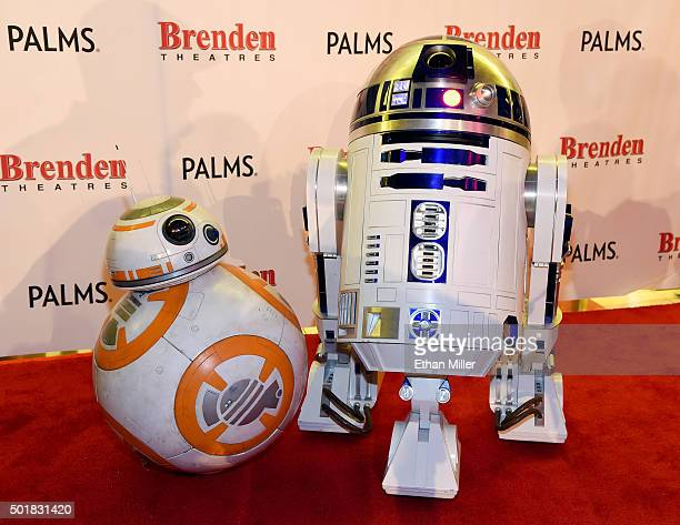 """And R2-D2 robots are displayed on opening night of Walt Disney Pictures And Lucasfilm's """"Star Wars: The Force Awakens"""" at the Brenden Theatres inside..."""