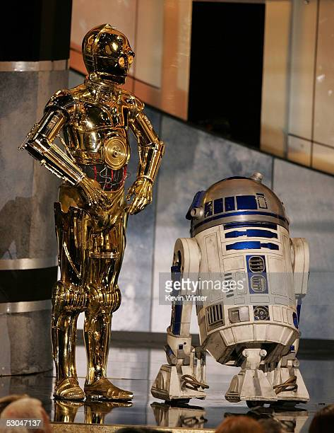 C3PO and R2D2 speak onstage during the 33rd AFI Life Achievement Award tribute to George Lucas at the Kodak Theatre on June 9 2005 in Hollywood...