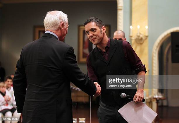 And radio personality George Stroumboulopoulos greets Governor General of Canada David Johnston at the podium during the 2012 NHL All-Star Game -...