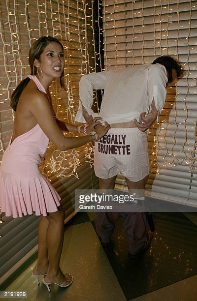 TV and radio presenter Toby Anstis has his trousers pulled down by model Leilani revealing the words Legally Brunette at the premiere party for...