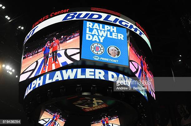 TV and Radio voice of the Los Angeles Clippers Ralph Lawler is honored before the game against the Washington Wizards on the jumbotron at STAPLES...