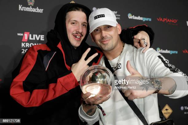 RIN and RAF Camora pose during the 1Live Krone radio award at Jahrhunderthalle on December 07 2017 in Bochum Germany