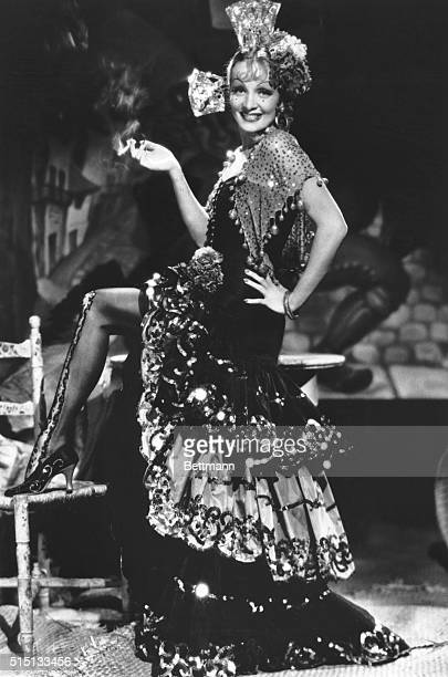 And ready for a most romantic evening in the most romantic Andalusia is Marlene Dietrich less severely attired than at any other time in her screen...