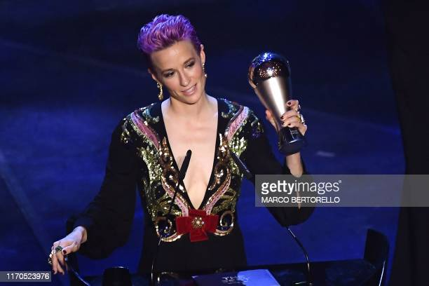 And Reign FC midfielder Megan Rapinoe reacts after winning the trophy for the Best FIFA Women's Player of 2019 Award during The Best FIFA Football...