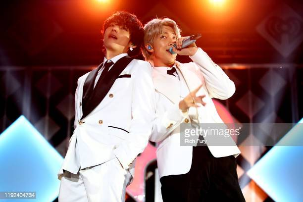 V and RM of BTS perform onstage during 1027 KIIS FM's Jingle Ball 2019 Presented by Capital One at the Forum on December 6 2019 in Los Angeles...