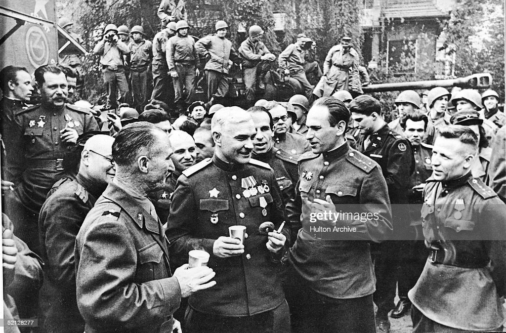 US and Russian commanders exchange stories at a meeting on the banks of the Elbe River, Torgau, Germany, April 28, 1945.