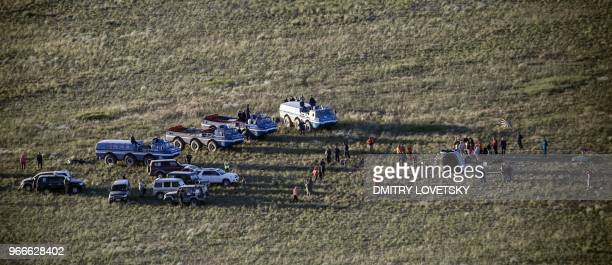 TOPSHOT NASA and Russian Emergency teams gather at the Russian Soyuz MS07 space capsule after its landing about 150 km southeast of the Kazakh town...