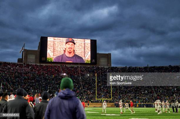 MLB and San Francisco Giants pitcher Jeff Samardzija is seen on the Jumbotron screen deivering a message to the fans during the college football game...