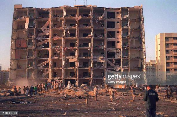 And Saudi Military Personnel Survey The Damage To Khobar Towers Caused By The Explosion Of A Fuel Truck June 25, 1996 Outside A Fence Around The...