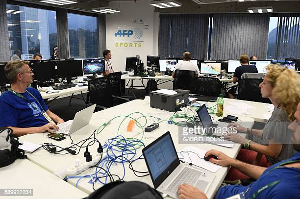AFP and SID journalists are seen at work at the Main Press Center of the Rio 2016 Olympic games on August 15 2016 in Rio de Janeiro An AFP team of...