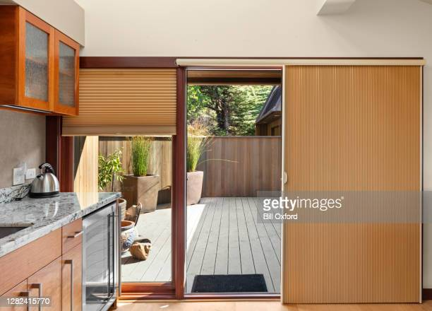 window treatments and blinds and sliding glass door coverings in home - sliding door stock pictures, royalty-free photos & images