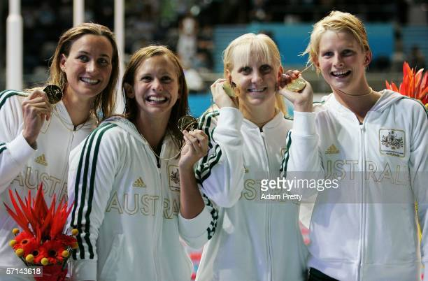 and Sophie Edington Lisbeth Lenton Jessicah Schipper and Leisel Jones of Australia proudly display the Gold medals won during their team's World...