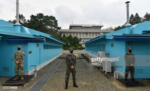 And South Korean army soldiers stand guard during South Korean Unification Minister Lee In-young's visit to Panmunjom between South and North Korea...