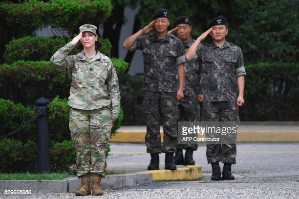 US and South Korean soldiers salute during a change of command ceremony for South Korea's General Kim ByungJoo incoming deputy commander of ROKUS...