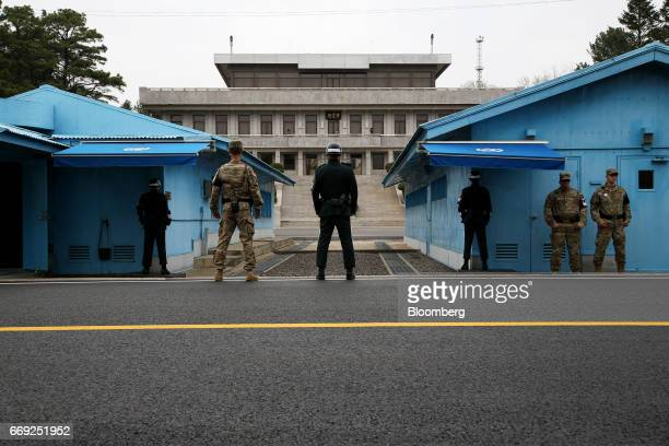 US and South Korean soldiers stand guard next to the meeting rooms that straddle the border between the two Koreas in the truce village of Panmunjom...