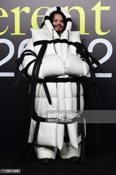 TOPSHOT DJ and Spaghetti Boys member Kerwin Frost poses as he arrives to attend the Moncler women's Fall/Winter 2019/2020 collection fashion show on...