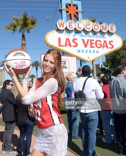 LVCVA and Sports Illustrated Model Cintia Dicker support the NCAA Basketball Conference Championship at the historic Las Vegas sign on February 14...