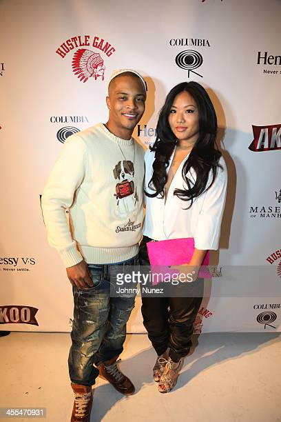 TI and Sue Tsai attend the Book Of Kings launch event hosted by TI and Iggy Azalea at Pillars 38 on December 11 2013 in New York City
