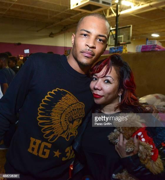 And Tameka 'Tiny' Harris attend Young Jeezy & T.I. Toy Drive at Metroplex Atlanta on December 20, 2013 in Atlanta, Georgia.