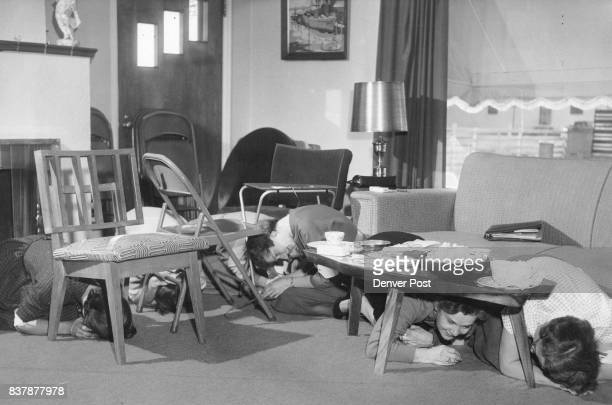 JAN 18 1956 JAN 19 1956 JUN 26 1982 JUN 27 1982 ***** and the women take cover under chairs coffee table and other furniture After the first alert...