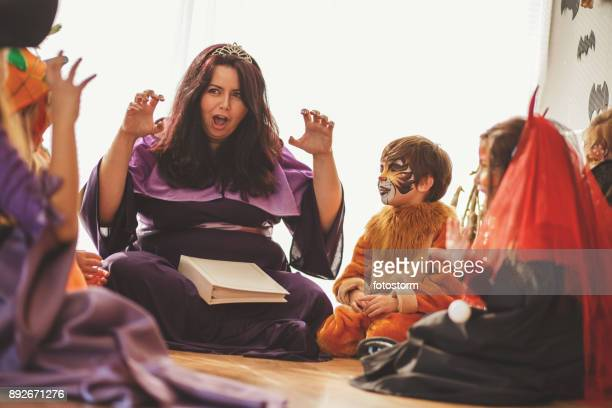 and then comes the scary creature... - halloween kids stock photos and pictures